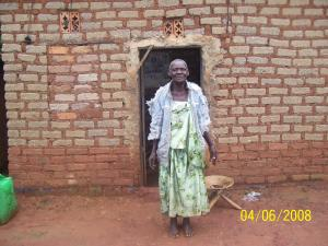 Grandmum- an elderly widow in Nkumba has no roof on her home to protect her from the rain.