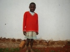 Miriam Mirembe.  She is an orphan brought to the church by someone who knew the parents.  John has never seen her laugh.