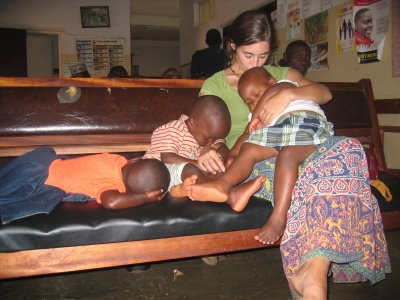 Katie taking children to be de-wormed (in Uganda)
