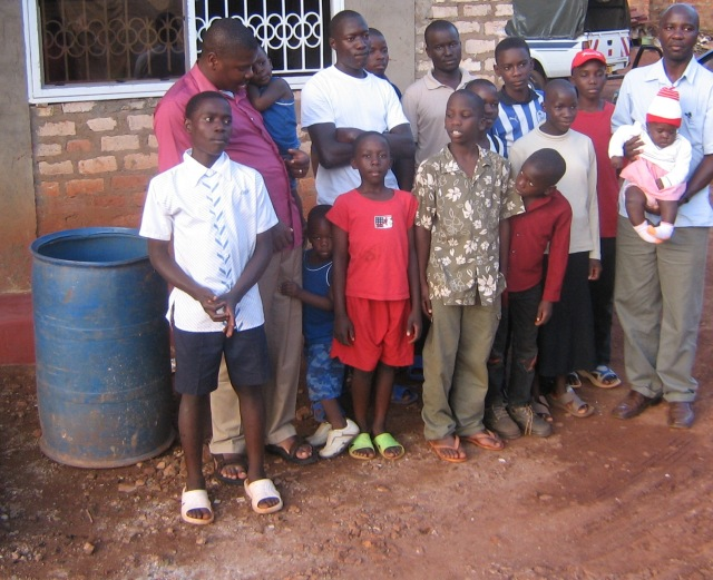 John with some of the orphans who live at his home (John is in the red shirt at left)