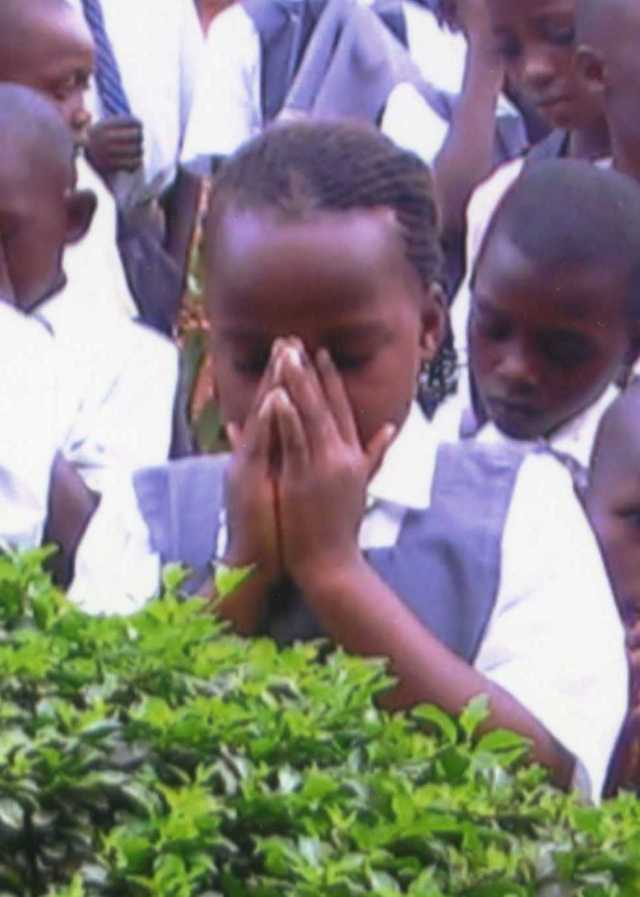 Praying girl at Nkumba