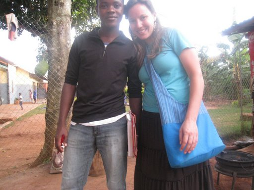 Cara Murray (who just returned from Uganda) with Brian.  Cara's note on the photo:  This is Brian.  He is in his final year at high school and desperately wants to go to college.  He has lost both of his parents and sister to AIDS.