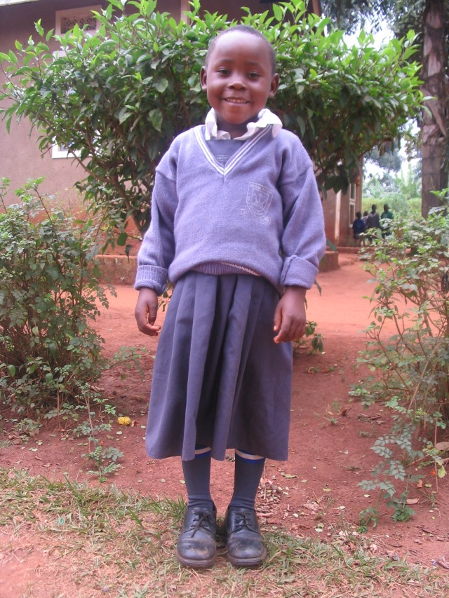 Pastor John writes: Kyosimire is one of hte most happy girls now.  But imagine her past: defiled, neglected and sleeping often without food.